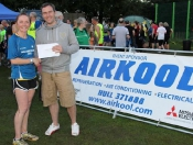 emma-brown-1st-lady-receives-her-prize-from-richard-dawson-of-airkool