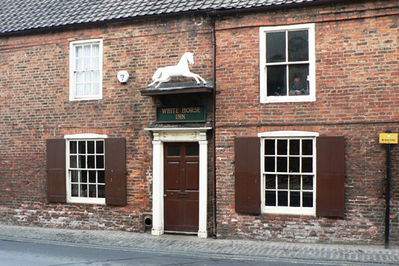 The White Horse Inn, more commonly known as Nellies by the locals, is like taking a step back in time as you enter this very historic and old public house in Beverley.