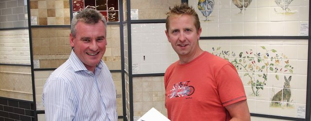 Ceramic Tile Merchants Present Competition Winner With iPad