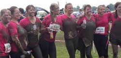 A team of women from a Beverley firm have completed the muddiest of challenges to raise money for the fight against cancer.
