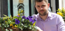 Allen Slinger hopes that his efforts to decorate his business in blue and yellow for the Tour de Yorkshire do not go unnoticed by the thousands of visitors expected in the town.